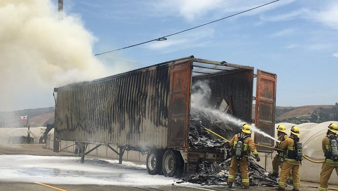 Ventura County fire crews work on a semitrailer fire Friday along Highway 118 in Somis.
