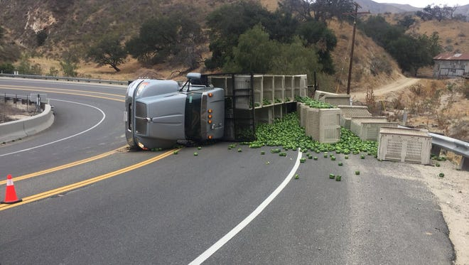 An overturned semitrailer blocked both lanes of Highway 23 north of Moorpark Tuesday, spilling bell peppers over the roadway.