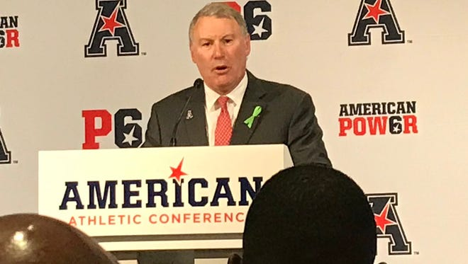 American Athletic Conference Commissioner Mike Aresco addresses reporters at the league's annual football media day Tuesday in Newport, Rhode Island.