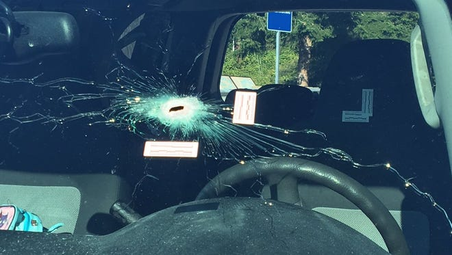 A gunshot hole in a windshield at the scene of a shooting on the Hood Canal Bridge.