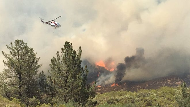 A fast-moving wildfire is forcing evacuations in the San Jacinto Mountains in an area southwest of Idyllwild, authorities said on Wednesday, July 25, 2018.