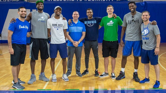 First-year coach Michael Fly (middle, hands together) and his staff welcomed a flock of former Eagles back into Alico Arena this week.