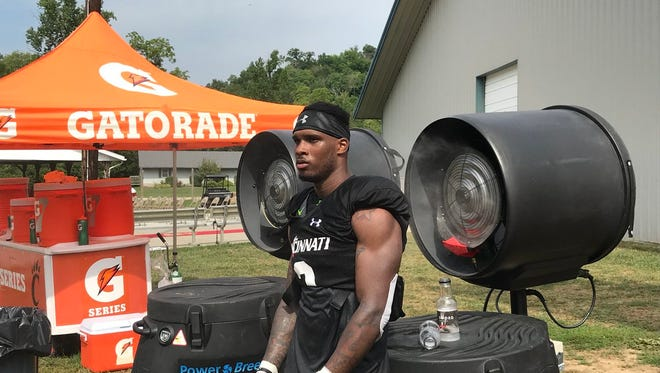 Cincinnati Bearcats senior cornerback Tyrell Gilbert (Princeton HS) cools off during a recent practice at Camp Higher Ground. Gilbert will be among the team's defensive leaders.