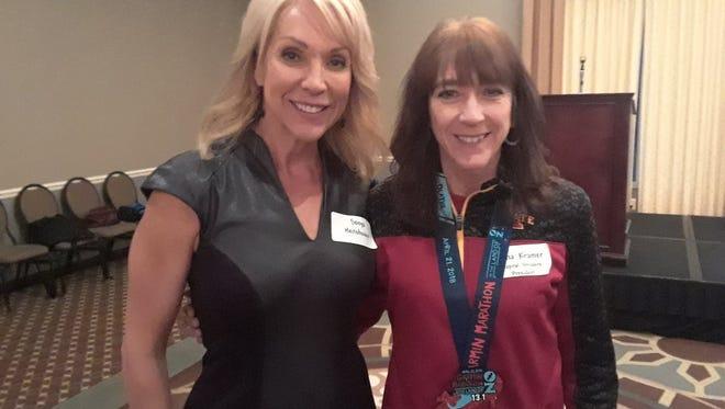 WHO-TV's Sonya Heitshusen, left, and Capital Striders president Dana Kramer on Friday.