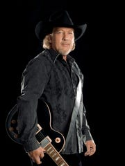 John Anderson performs at the Dixie National Rodeo Sunday, Feb. 10.