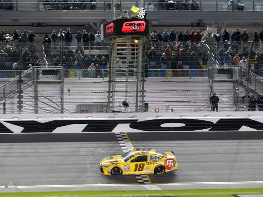 Kyle Busch crosses the finish line to win the second of two qualifying races for Sunday's NASCAR Daytona 500 Sprint Cup series auto race at Daytona International Speedway in Daytona Beach, Fla., Thursday, Feb. 18, 2016. (AP Photo/Terry Renna)
