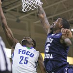 FGCU's Marc-Eddy Norelia (25) shoots past UNF's Chris Davenport during the basketball game at Alico Arena on Saturday, February 6, 2016.  Photo by Gregg Pachkowski