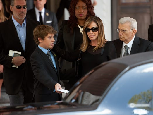 Joan Rivers' daughter, Melissa Rivers, and Melissa's son, Cooper Endicott, 13, arrive for Joan Rivers' memorial service at Temple Emanu-El on Sept. 7, 2014, in New York City. Rivers died on Sept. 4 after suffering respiratory and cardiac arrest during vocal cord surgery on Aug. 28.