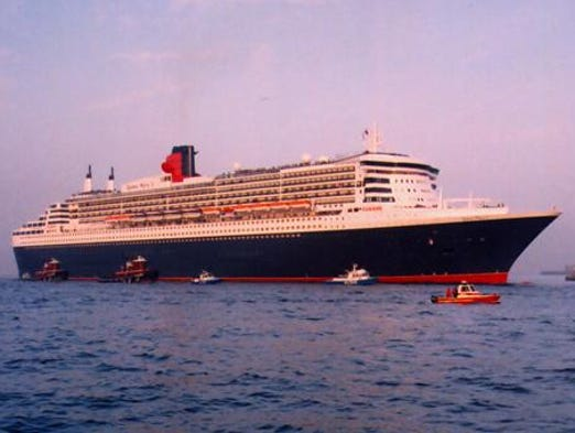 """Cunard Line's 151,400-ton, 2,620-guest flagship Queen Mary 2 was the world's largest passenger ship at the time of her debut in 2003. Although the term """"ocean liner"""" is used to describe some cruise ships, the QM2 is a bonafide dual-purpose liner and cruise ship. She is shown here on her April 22, 2004 maiden arrival in New York."""