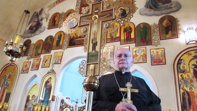 Father Daniel Mahler, pastor of St. Mary's Orthodox Church in Corning, stands in the church sanctuary. The church is celebrating its centennial this year.