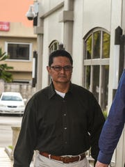In this March 29, 2017, file photo, Glenn Wong, left, enters the District Court of Guam building with his attorney, James Maher. Wong and former Guam Housing and Urban Renewal Authority attorney Mark Smith face charges of wire fraud and money laundering, in relation to the collection of federal Section 8 housing funds.