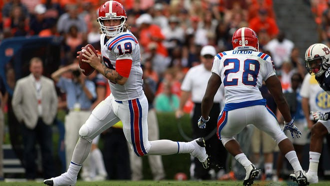 Louisiana Tech senior quarterback Cody Sokol rolls out to pass while teammate Kenneth Dixon protects his back during Tech's game earlier this season against Auburn.
