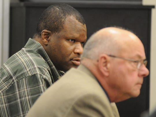 Preston Fenderson sits with defense attorney, Robert Whitney, at his 2009 trial.