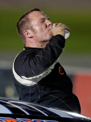 Brent Strelka gets a drink of water following his first career Super Late Model win during the final night of racing for the season at Wisconsin International Raceway on Thursday, September 1, 2016 in Kaukauna, Wisconsin.