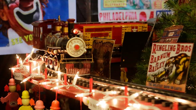 A model train whizzes around a 12-foot tall live Christmas tree Saturday, Dec. 20, at the Linden Depot Museum. The museum will have nearly 2,000 visitors during the entire Christmas Open House season.
