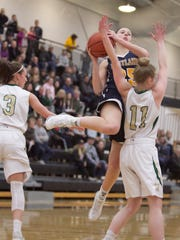 Lexey Tobel drives to the basket in one of Hartland's four victories over Howell in 2016-17.