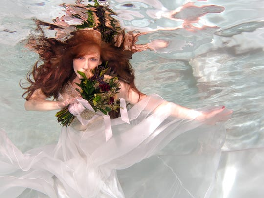One of the many underwater photographers you can view