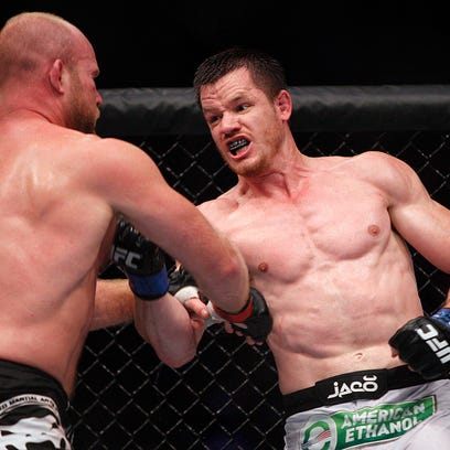 Tim Boetsch, left, takes a shot from C.B. Dollaway,  in their middleweight bout last year.