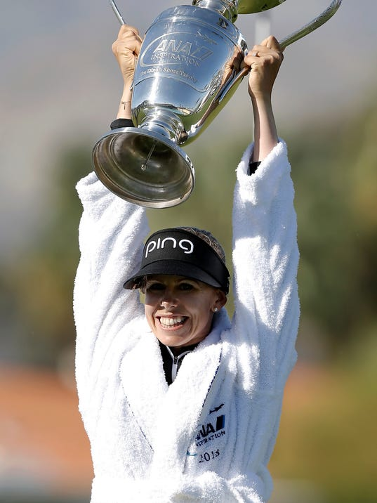 Pernilla Lindberg, of Sweden, holds up her trophy after winning on the 10th hole during the eighth playoff round to win the LPGA Tour ANA Inspiration golf tournament over Inbee Park, of South Korea, at Mission Hills Country Club in Rancho Mirage, Calif., Monday, April 2, 2018. (AP Photo/Alex Gallardo)