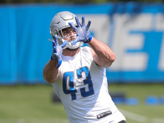 Lions fullback Nick Bellore goes through drills during OTAs on May 24, 2018, at the Allen Park practice facility.