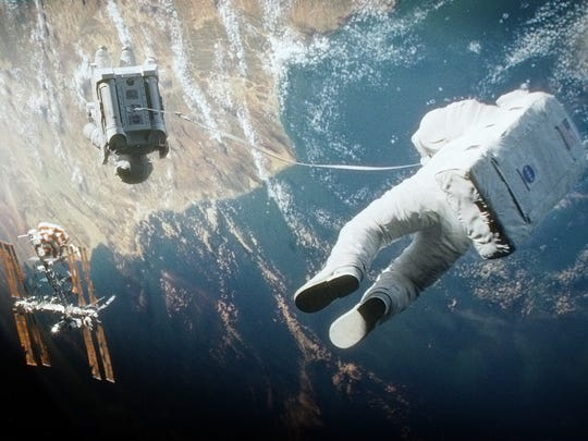 """""""Gravity,"""" starring Sandra Bullock, George Clooney and Ed Harris, tells the tale of an astronaut stranded in space."""