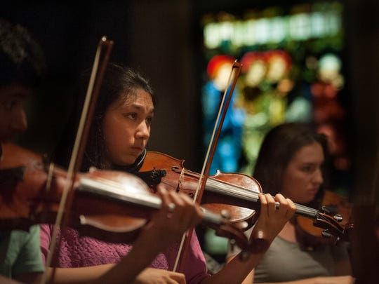 Faustina Housner plays violin during a rehearsal of the Philadelphia Youth Sinfonia at St. Stephen's Church, Philadelphia. Sinfonia is a youth orchestra for gifted young musicians ages 11 through 22 in two groups, divided by age.