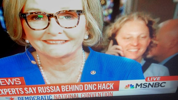 "State Rep. Kevin Schreiber, D-York City, is seen standing behind Sen. Claire McCaskill as she's interviewed on MSNBC at the Democratic National Convention on Monday, July 25, 2016. He can be seen mouthing, ""I love you, Jenny,"" to his wife."