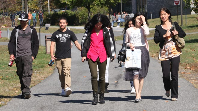 Students walk to class on the campus of Westchester Community College Oct. 8, 2014.