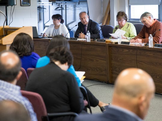 Muncie Community Schools spokesperson Anny Pichardo, left, sits next to then-Superintendent Steve Baule and school board members in this file photo.