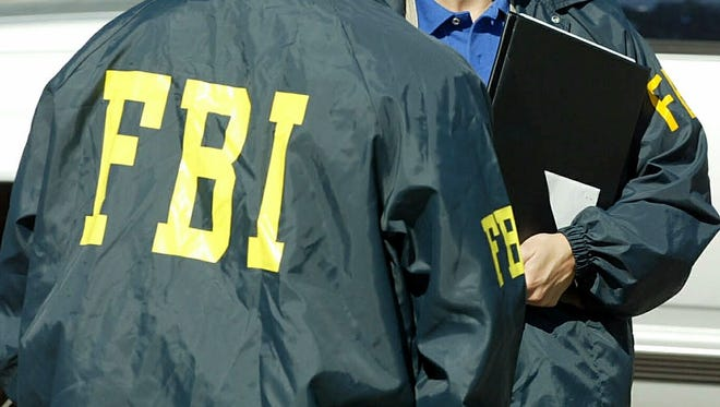 The FBI and the IRS served simultaneous search warrants at the Phoenix and Chandler offices of Advanced Green Innovations on Tuesday.
