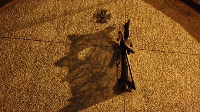 The shadow cast by the statue of St. Patrick, which some interpret to look like Satan.