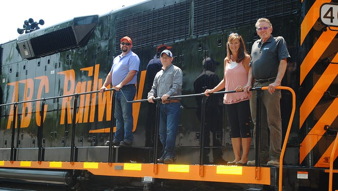 Celebrating the completion of the Chestnut Commerce Rail spur and transloading facility recently were, from left, Herb Shanklin, general manager at ABC Railway, Nate Walden of EnviroServe, Ann and Ray Harner, owners of Chestnut Commerce Center and the new rail spur.