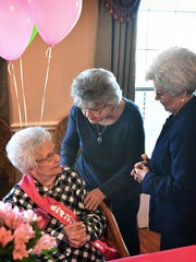 Ava Simmons, seated, receives happy birthday wishes