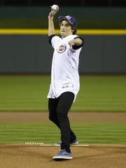 Olympic Bronze medalist Nick Goepper throws out the first pitch on Opening Night before the start of the Cincinnati Reds game against the Saint Louis Cardinals at Great American Ball Park Wednesday April , 2014.