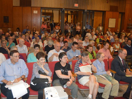 About 170 Scarsdale residents attended a meeting at Village Hall over the latest revaluation.