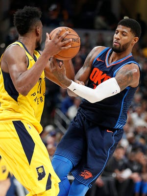 Oklahoma City Thunder forward Paul George (13) fouls Indiana Pacers forward Thaddeus Young (21) in the second half of their game at Bankers Life Fieldhouse Wednesday, Dec 13, 2017. The Oklahoma City Thunder defeated the Indiana Pacers 100-95.