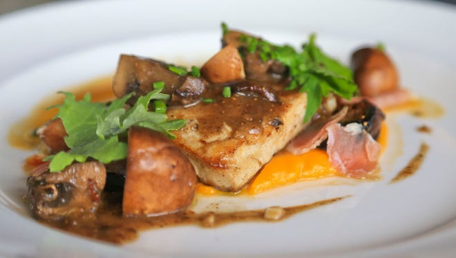 Chef Sean Ward of Ward 426 is using Kentucky Blue Carp -- an invasive species -- from sandwich to dinner entrees. The fish here is paired with Kentucky smoked ham and mushrooms with smoked figs with a sweet potato puree.