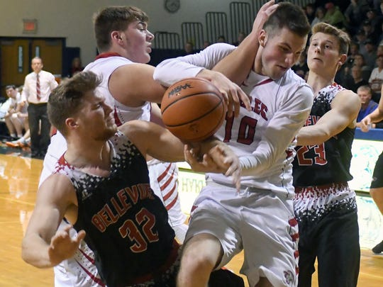 Bellevue's Ryan Madry (32) battles for a rebound and draws the penalty midway throug the third quarter of play Wednesday night.