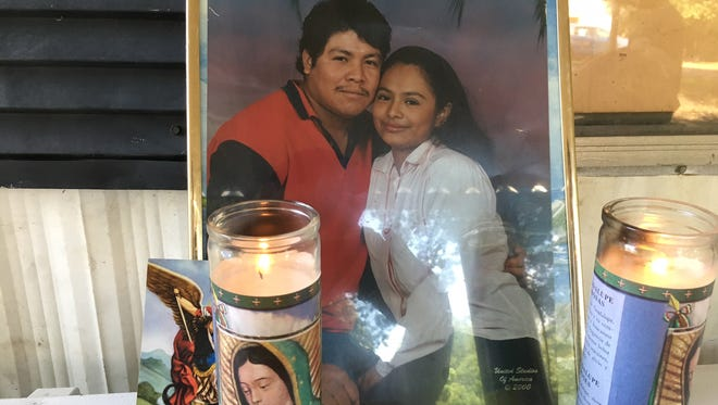 A photo of Ismael Lopez and his wife, Claudia Linares, was set up outside the home in Southaven where he was fatally shot.