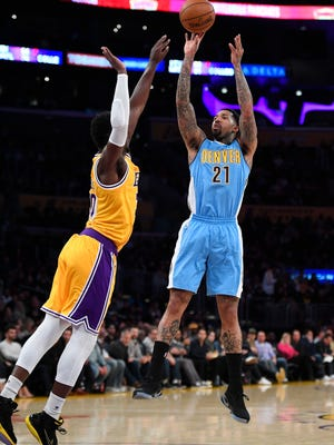 Denver Nuggets forward Wilson Chandler shoots as Los Angeles Lakers forward Julius Randle defends during the first half of an NBA basketball game, Tuesday, Jan. 17, 2017, in Los Angeles. (AP Photo/Mark J. Terrill)