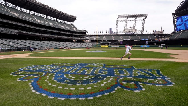 Jake Catterall, 12, of Tacoma, Wash., races toward first base and past a partially-completed opening day logo during a practice run around the bases at the Mariners' ballpark Friday, April 3, 2015, in Seattle. Jake, a Make-A-Wish recipient who lives with intractable epilepsy, will make the traditional ceremonial run at the Mariners' opening day game Monday, April 7, against the Los Angeles Angels. Jake also plays for a Little League baseball team.
