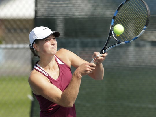 Fond du Lac's Kellie Hierl makes a backhand return