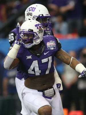 TCU LB Paul Dawson celebrates a sack.