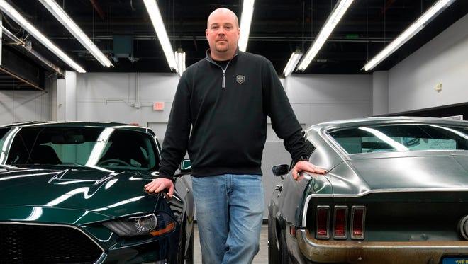 """Sean Kiernan of Nashville, Tennessee is the owner of the """"Bullitt"""" car.  He is photographed with the 2019 Ford Mustang Bullitt on the left and the 1968 Ford Mustang Fastback from the 1968 movie Bullitt on the right."""