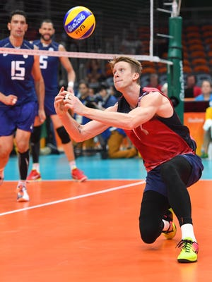 Max Holt, a Purcell Marian graduate, drops down to dig the ball against Italy on Aug 19 in Rio de Janeiro.