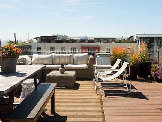 A rooftop patio in the city.