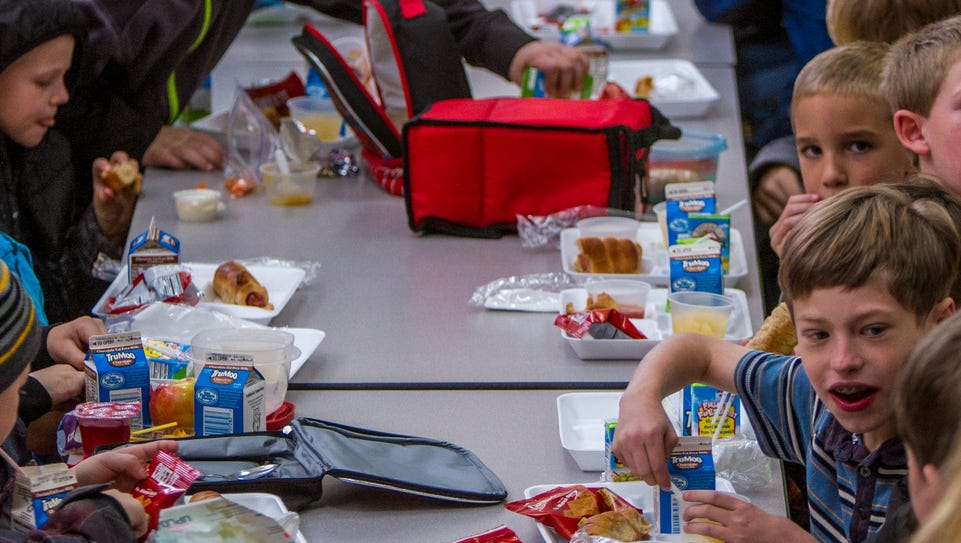 Student at East Elementary in Cedar City eat lunch,