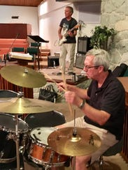 Jeff Munzinger plays the drums. In the background is