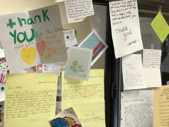 Thank-you notes paper the walls at Arizona Helping