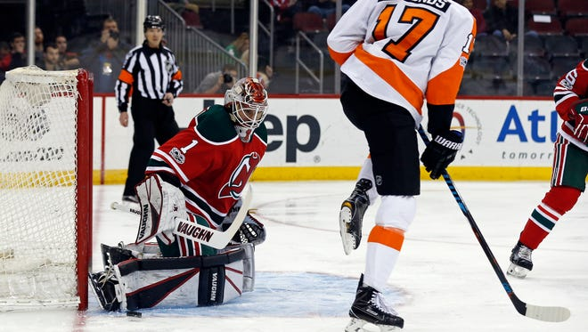 Devils goalie Keith Kinkaid makes one of his 17 saves against the Flyers on Thursday night in Newark. Kindaid was back in the net on Friday against Pennsylvania's other team, the Penguins, in Pittsburgh.